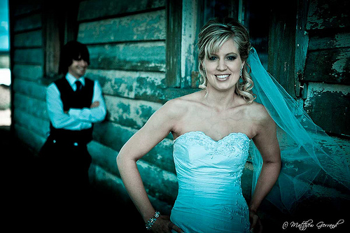 Bride_With_Groom_Looking_On