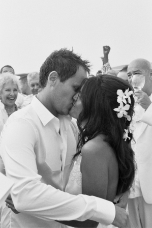 Black and white photo of newlyweds kissing on Fire Island beach by China Jorrin