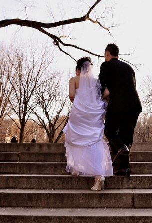 Just another statistic; newlyweds climbing up stairs