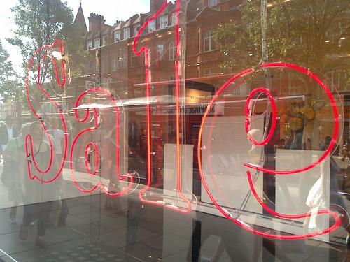 sale on glass window