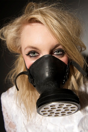 A bride wearing a gas mask