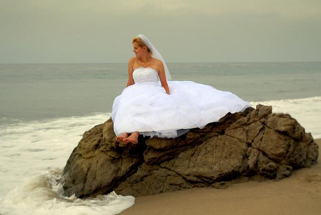 bride posing in the beach