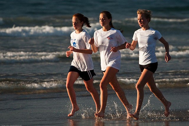 women running on the sand