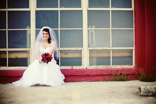 bride posing on the window