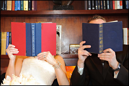 bride and groom reading