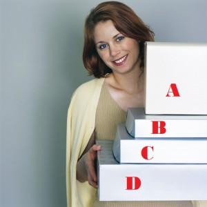 lady holding boxes of packages