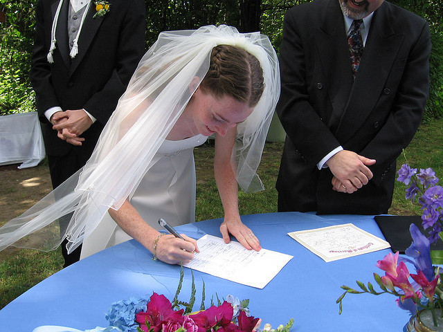 Bride Signing Contract