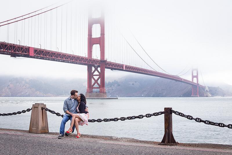 Couple kissing under the bridge